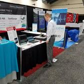Fil setting up the OptiGauge before Day 3 Photonics West begins